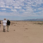 Students ponder restoration aspects in an arid landscape devoid of plant cover